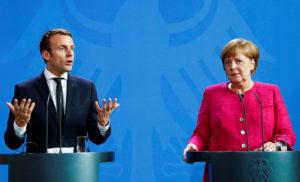 Меркель спільно із Макроном закликали Путіна та Порошенка виконати підписані угоди